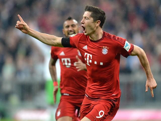 Bayern Munich's Polish striker Robert Lewandowski celebrates after the third goal for Munich during the German first division Bundesliga football match FC Bayern Muenchen vs VfL Wolfsburg in Munich, on September 22, 2015.