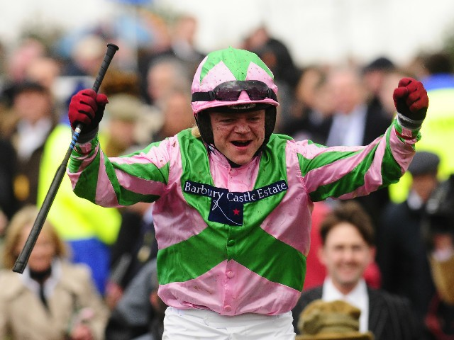 Jockey Robert Thornton celebrates victory after winning The Smurfit Kappa Champion Hurdle on Katchit at Cheltenham Racecourse on March 11, 2008 in Cheltenham, England.