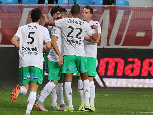 Saint-Etienne's teammates celebrate after Saint-Etienne's French midfielder Benjamin Corgnet scored a goal during the French L1 football match between Troyes and Saint-Etienne on September 23, 2015