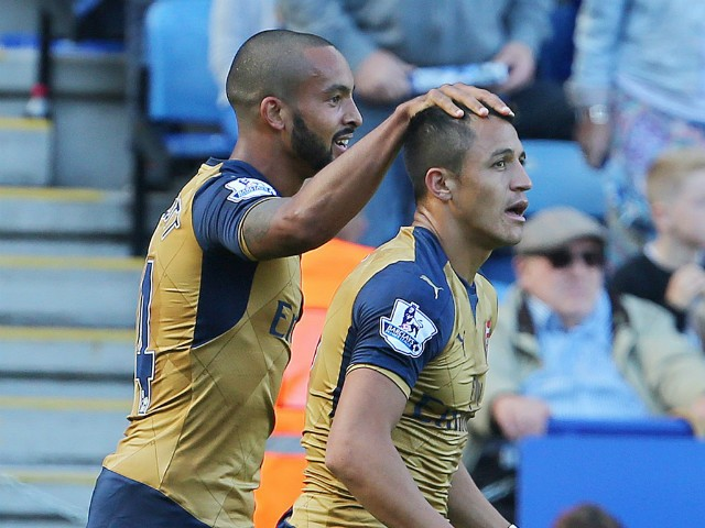 Arsenals English striker Theo Walcott (L) congratulates Arsenals Chilean striker Alexis Sanchez after Sanchez scored his team's second goal during the English Premier League football match between Leicester City and Arsenal at King Power Stadium in Leices