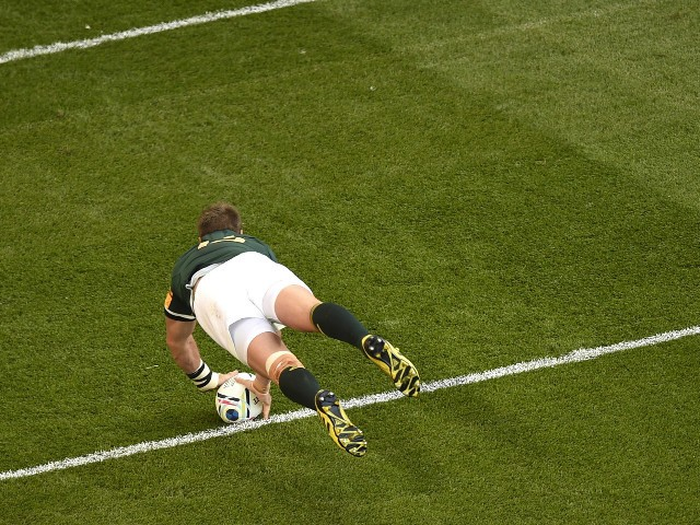 South Africa's centre and captain Jean de Villiers jumps to score his team's second try during the Pool B match of the 2015 Rugby World Cup between South Africa and Samoa at Villa Park in Birmingham, central England, on September 26, 2015.