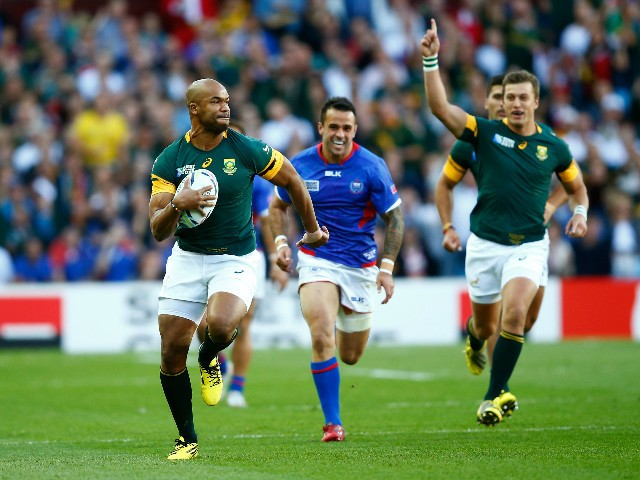 JP Pietersen of South Africa breaks clear to score the opening try during the 2015 Rugby World Cup Pool B match between South Africa and Samoa at Villa Park on September 26, 2015 in Birmingham, United Kingdom.