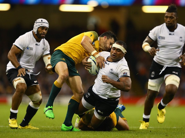 Talemaitoga Tuapati of Fiji is stopped by Adam Ashley-Cooper (L) and Kurtley Beale of Australia during the 2015 Rugby World Cup Pool A match between Australia and Fiji at the Millennium Stadium on September 23, 2015