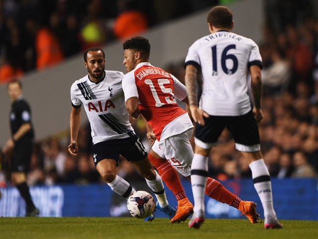Alex Oxlade-Chamberlain of Arsenal is watched by Andros Townsend (L) and Kieran Trippier of Tottenham Hotspur (R) during the Capital One Cup third round match between Tottenham Hotspur and Arsenal at White Hart Lane on September 23, 2015