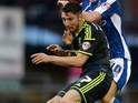 James Husband of Middlesbrough is tackled by Danny Philliskirk of Oldham during the Capital One Cup First Round match between Oldham Athletic and Middlesbrough at Boundary Park on August 12, 2014 in Oldham, England.
