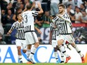 Juventus' forward Alvaro Morata from Spain (R) celebrates with teammate Juventus' defender from Italy Giorgio Chiellini after scoring during the Italian Serie A football match Juventus Vs Bologna on October 4, 2015