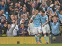 Manchester City's Argentinian striker Sergio Aguero (L) celebrates with Manchester City's Spanish midfielder Jesus Navas after scoring his third goal during the English Premier League football match between Manchester City and Newcastle United at The Etih
