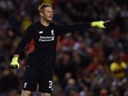 Liverpool's Hungarian goalkeeper Adam Bogdan gestures during the English League Cup football match between Liverpool and Carlisle United at Anfield in Liverpool, England on September 23, 2015.