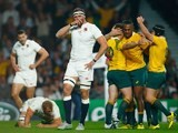 England's Chris Wood reacts after Bernard Foley scores the opening try during the Rugby World Cup match with Australia on October 3, 2015