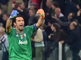 Juventus' goalkeeper from Italy Gianluigi Buffon celebrates after teammate Juventus' forward from Italy Simone Zaza scored during the UEFA Champions League football match Juventus vs FC Sevilla on September 30, 2015