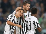 Juventus' forward Paulo Dybala from Argentina celebrates after scoring with his teammate Juventus' forward Alvaro Morata from Spain during the Italian Serie A football match Juventus Vs Bologna on October 4, 2015