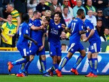 Jamie Vardy (3rd L) of Leicester City celebrates scoring his team's first goal with his team mates during the Barclays Premier League match between Norwich City and Leicester City at Carrow Road on October 3, 2015