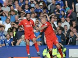 Liverpool's English striker Danny Ings (L) celebrates with Liverpool's Slovakian defender Martin Skrtel after scoring the opening goal during the English Premier League football match between Everton and Liverpool at Goodison Park in Liverpool north west