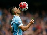 Sergio Aguero of Manchester City kisses the ball to celebrate a goal during the Barclays Premier League match between Manchester City and Newcastle United at Etihad Stadium on October 3, 2015