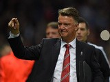 Manchester United's Dutch coach Louis van Gaal gestures as he arrives on the pitch ahaed of the UEFA Champions League Group B football match between Manchester United and VfL Wolfsburg at Old Trafford in Manchester, north west England, on September 30, 20