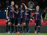 Paris Saint-Germain's Swedish forward Zlatan Ibrahimovic (L) is congratulated by teammates after scoring a penatly during the French L1 football match Paris Saint-Germain (PSG) vs Olympique de Marseille (OM) on October 4, 2015