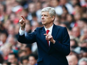 Arsene Wenger manager of Arsenal gestures on the touchline during the Barclays Premier League match between Arsenal and Manchester United at Emirates Stadium on October 4, 2015 in London, England.