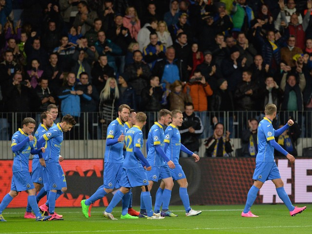 BATE's players celebrate a goal during the UEFA Champions League group E football match between FC BATE Borisov and AS Roma at the Borisov-Arena in Borisov outside Minsk on September 29, 2015.
