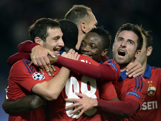 CSKA Moscow's players celebrate a goal during the UEFA Champions League group B football match between CSKA Moscow and PSV Eindhoven at the Khimki Arena outside Moscow on September 30, 2015