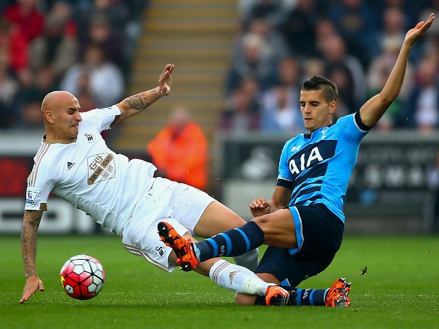 Jonjo Shelvey of Swansea City and Erik Lamela of Tottenham Hotspur during the Barclays Premier League match between Swansea City and Tottenham Hotspur at Emirates Stadium on October 4, 2015 in Swansea, Wales.