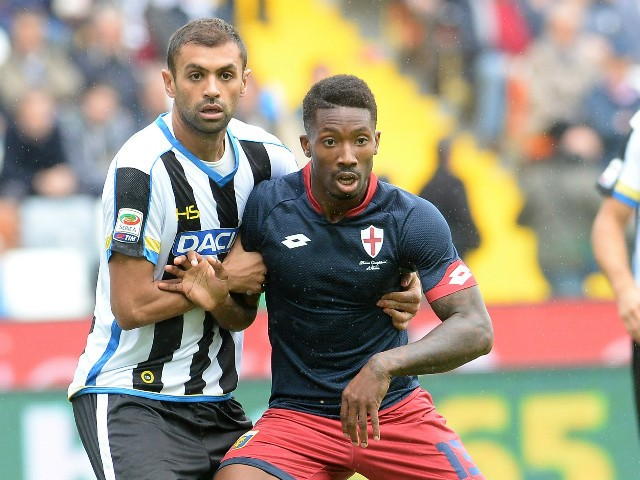 Danilo Larangeira of Udinese Calcio competes with Serge Gakpe of Genoa CFC during the Serie A match between Udinese Calcio and Genoa CFC at Stadio Friuli on October 4, 2015 in Udine, Italy.