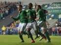 Steve Davis (L) of Northern Ireland celebrates after scoring during the UEFA EURO 2016 qualifier between Northern Ireland and Greece at Windsor Park on October 8, 2015 in Belfast, Northern Ireland.