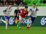 Faroe Island's Rene Joensen (R) and Solvi Vatnhamar (L) vies with Hungary's Adam Nagy (C) during the Euro 2016 Group F qualifying football match between Hungary and Faroe Islands at the Groupama Arena in Budapest, Hungary on October 8, 2015.