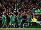 Shane Long of Republic of Ireland celebrates scoring the opening goal team mates in front of the fans during the UEFA EURO 2016 Qualifier group D match between Republic of Ireland and Germany at the Aviva Stadium on October 8, 2015 in Dublin, Ireland.