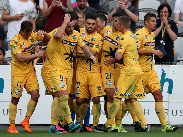 Mariners team mates celebrate a goal with team mates during the round one A-League match between the Central Coast Mariners and the Perth Glory at Central Coast Stadium on October 10, 2015