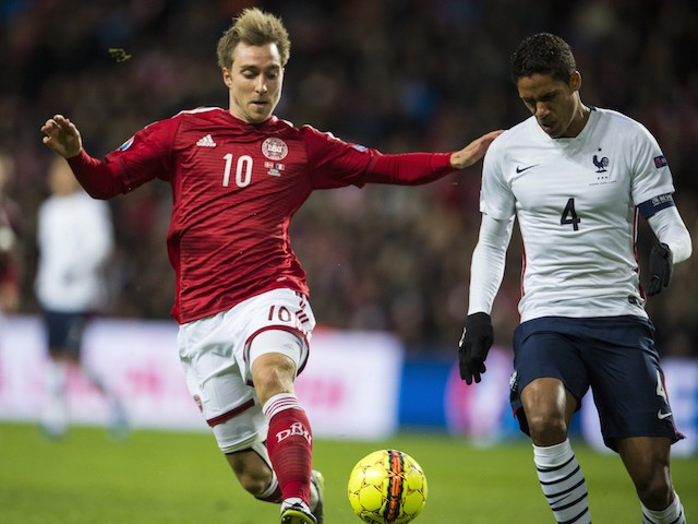 Denmark's midfielder Christian Eriksen (L) and France's defender Raphael Varane vie for the ball during a friendly international football match between Denmark and the hosts of the Euro 2016 France at Parken arena in Copenhagen on October 11, 2015.