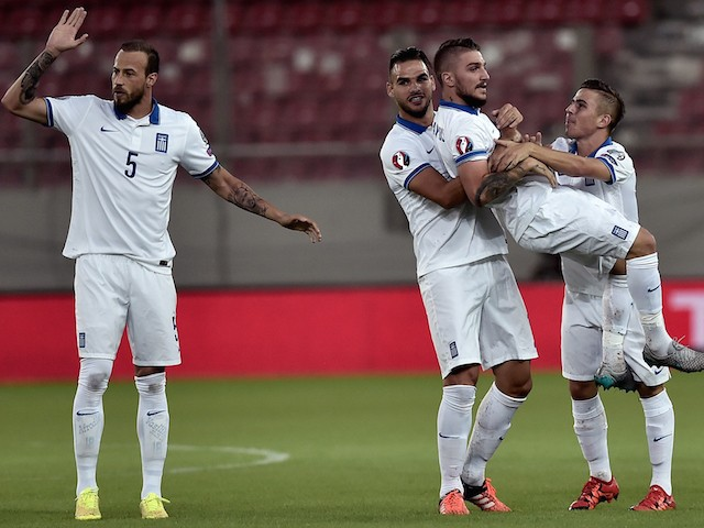 Greece's Kostas Stafylidis (2nd R) is lifted by teammate after he scored during the UEFA Euro 2016 qualifying Group F football match between Greece and Hungary at the Stadio Georgios Karaiskakis in Athens on October 11, 2015.