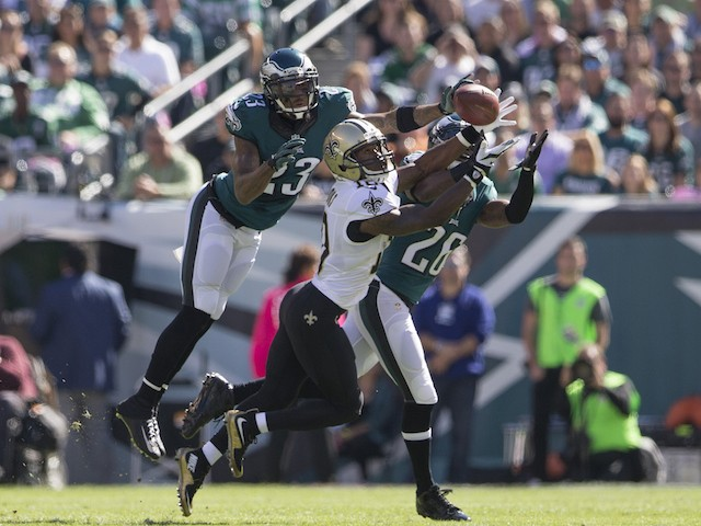 Nolan Carroll #23 and Walter Thurmond #26 of the Philadelphia Eagles break up a pass intended for Brandin Cooks #10 of the New Orleans Saints on October 11, 2015 at Lincoln Financial field in Philadelphia, Pennsylvania.