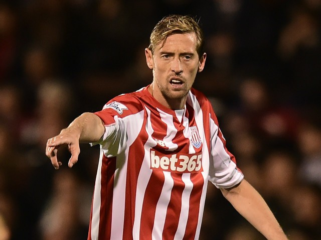 Peter Crouch of Stoke City gestures during the Capital One Cup Third Round match between Fulham and Stoke City at Craven Cottage on September 22, 2015 in London, United Kingdom.
