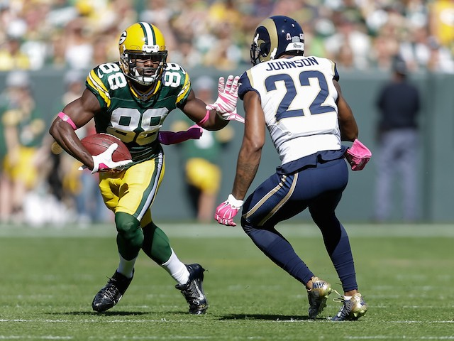 Ty Montgomery #88 of the Green Bay Packers carries the football against Trumaine Johnson #22 of the St. Louis Rams in the first quarter at Lambeau Field on October 11, 2015 in Green Bay, Wisconsin.