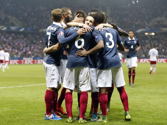 France's midfielder Yohan Cabaye (C) celebrates with teammates after scoring a goal during the friendly football match between France and Armenia on October 8, 2015 at the Allianz Riviera stadium in Nice, southeastern France.