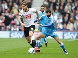 Jack Price of Wolverhampton Wanderers FC puts pressure on Jeff Hendrick of Derby County FC in a tackle during the Sky Bet Championship match between Derby County and Wolverhampton Wanderers at Pride Park Stadium on October 18, 2015 in Derby, England.