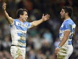 Argentina's wing Juan Imhoff (L) celebrates after scoring his team's fourth try during a quarter final match of the 2015 Rugby World Cup between Ireland and Argentina at the Millennium Stadium in Cardiff, south Wales, on October 18, 2015.