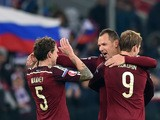 Russia's midfielder Pavel Mamaev, Russia's defender Sergei Ignashevich and Russia's forward Aleksandr Kokorin celebrate their victory over Montenegro after the UEFA Euro 2016 group G qualifying football match between Russia and Montenegro at the Otkrytie