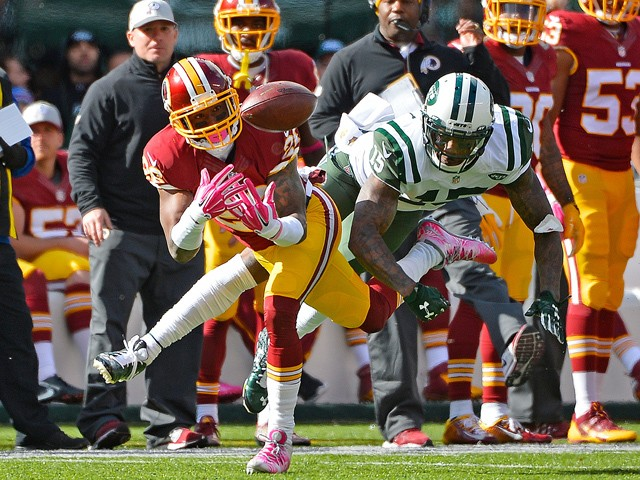Bashaud Breeland #26 of the Washington Redskins intercepts a pass intended for Brandon Marshall #15 of the New York Jets during the second quarter at MetLife Stadium on October 18, 2015