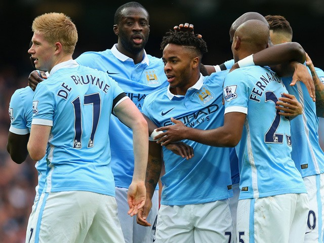 Raheem Sterling of Manchester City celebrates scoring his team's first goal with his team mates during the Barclays Premier League match between Manchester City and A.F.C. Bournemouth at Etihad Stadium on October 17, 2015