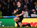 Beauden Barrett of the New Zealand All Blacks celebrates aftrer he scores the second New Zealand try during the 2015 Rugby World Cup Semi Final match between South Africa and New Zealand at Twickenham Stadium on October 24, 2015
