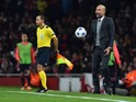 Bayern Munich's Spanish head coach Pep Guardiola reacts as he holds a ball that went out of play during the UEFA Champions League football match between Arsenal and Bayern Munich at the Emirates Stadium in London, on October 20, 2015.