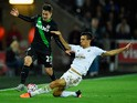 Bojan Krkic of Stoke City is tackled by Jack Cork of Swansea City during the Barclays Premier League match between Swansea City and Stoke City at Liberty Stadium on October 19, 2015