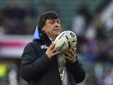 Argentina's head coach Daniel Hourcade holds a ball prior to a semi-final match of the 2015 Rugby World Cup between Argentina and Australia at Twickenham Stadium, southwest London, on October 25, 2015