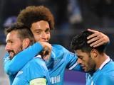 Zenit's Portuguese midfielder Miguel Danny, Zenit's Belgian midfielder Axel Witsel and Zenit's Brazilian forward Hulk celebrate a goal during the UEFA Champions League group H football match between FC Zenit and Olympique Lyonnais at the Petrovsky stadium