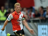 Dirk Kuyt of Feyenoord runs with the ball during the pre season friendly match between Feyenoord Rotterdam and Southampton FC at De Kuip on July 23, 2015
