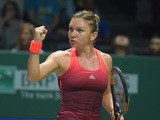 Simona Halep of Romania celebrates winning a point against Falvia Pennetta of Italy during their season-ending tennis WTA Final in Singapore on October 25, 2015