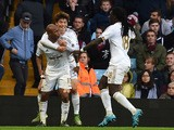Swansea City's Ghanaian striker Andre Ayew (L) celebrates with Swansea City's Korean midfielder Ki Sung-Yueng and Swansea City's French striker Bafetimbi Gomis (R) after scoring their second goal during the English Premier League football match between As