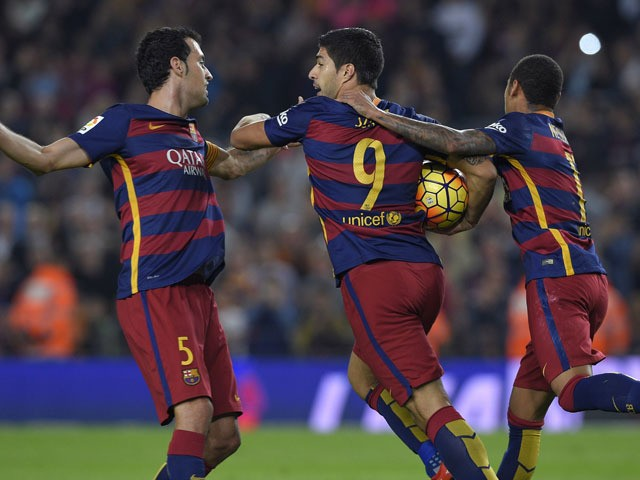 Barcelona's Uruguayan forward Luis Suarez (C) celebrates a goal with teammates Brazilian forward Neymar (R) and midfielder Sergio Busquets (L) during the Spanish league football match FC Barcelona vs SD Eibar at the Camp Nou stadium in Barcelona on Octobe
