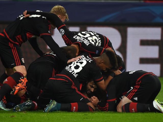 Leverkusen´s players celebrate scoring during the Group E, first-leg UEFA Champions League football match Bayer Leverkusen vs AS Roma in Leverkusen, western Germany on October 20, 2015.